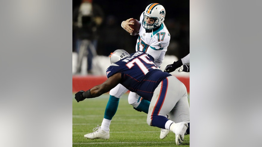 New England Patriots defensive tackle Vince Wilfork (75) sacks Miami Dolphins quarterback Ryan Tannehill (17) during the third quarter of an NFL football game in Foxborough, Mass., Sunday, Dec. 30, 2012. (AP Photo/Charles Krupa)