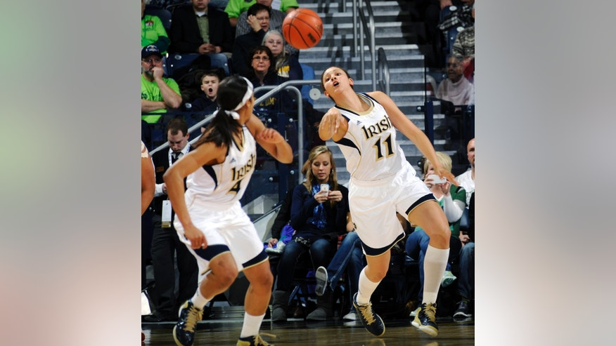 Notre Dame forward Natalie Achonwa throws a pass upcourt to Skylar Diggins during the first half of an NCAA college basketball game against Saint Francis, Monday, Dec. 31, 2012, in South Bend, Ind. (AP Photo/Joe Raymond)