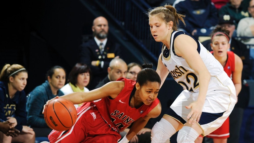 Saint Francis guard Rebecca Sparks, left, attempts to drive the lane around Notre Dame guard Madison Cable during the first half of an NCAA college basketball game, Monday, Dec. 31, 2012, in South Bend, Ind. (AP Photo/Joe Raymond)