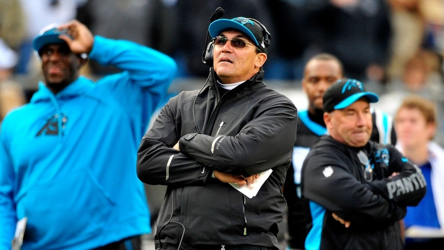 CHARLOTTE, NC - NOVEMBER 18:  Coach Ron Rivera of the Carolina Panthers watches the replay board after his team was called for a late hit personal foul late in the fourth quarter against the Tampa Bay Buccaneers at Bank of America Stadium on November 18, 2012 in Charlotte, North Carolina. Tampa Bay won 27-21 in overtime.  (Photo by Grant Halverson/Getty Images)