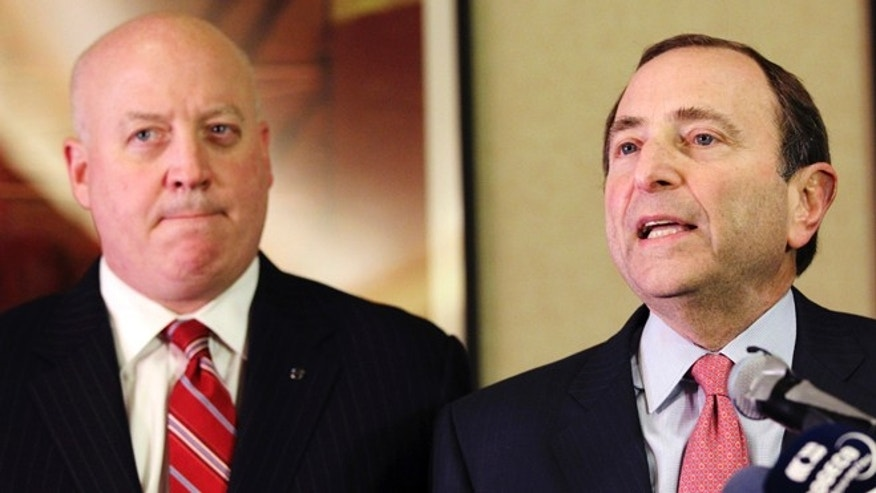 Dec. 6, 2012: In this file photo, NHL Commissioner Gary Bettman, right, and deputy commissioner Bill Daly speak to reporters in New York.