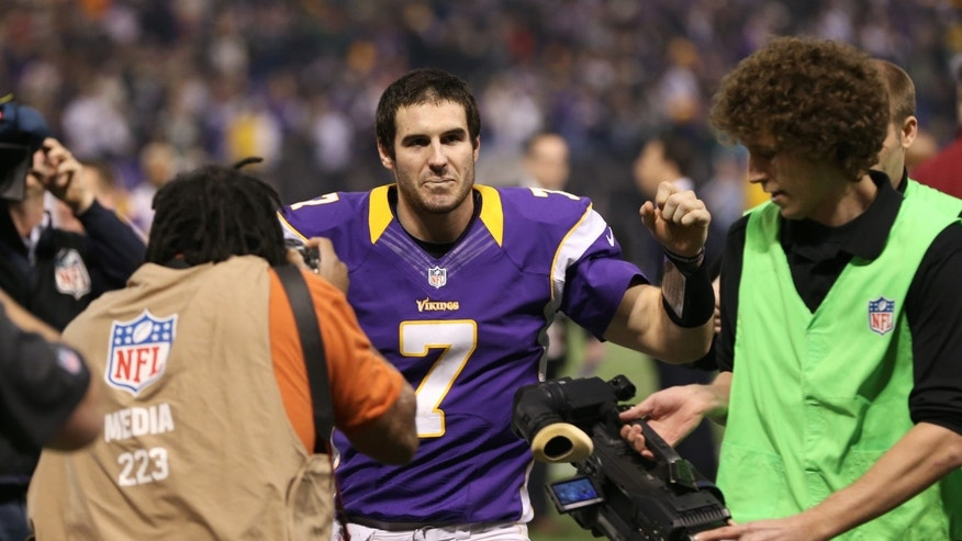 Minnesota Vikings quarterback Christian Ponder walks off the field after an NFL football game against the Green Bay Packers Sunday, Dec. 30, 2012, in Minneapolis. The Vikings won 37-34. (AP Photo/Jim Mone)
