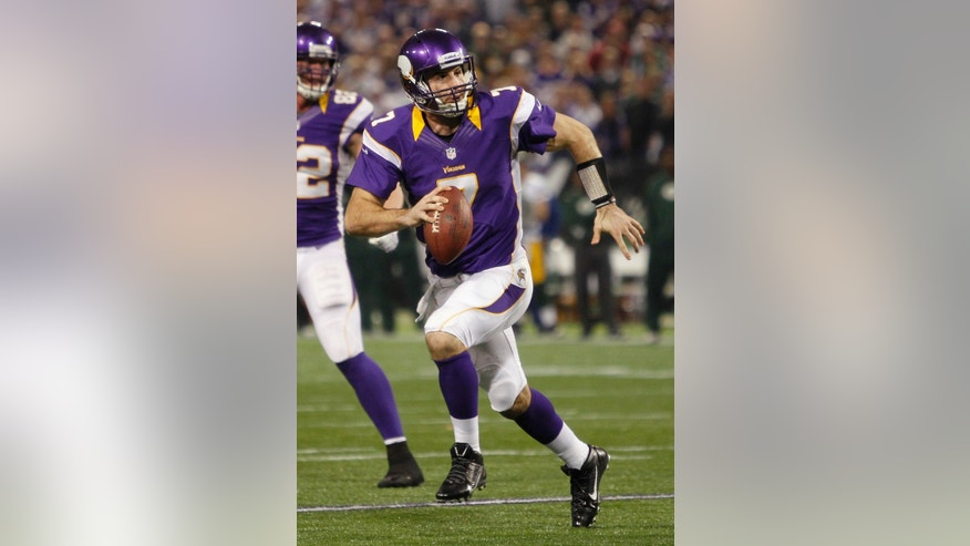Minnesota Vikings quarterback Christian Ponder looks to pass during the second half of an NFL football game against the Green Bay Packers Sunday, Dec. 30, 2012, in Minneapolis. The Vikings won 37-34. (AP Photo/Genevieve Ross)