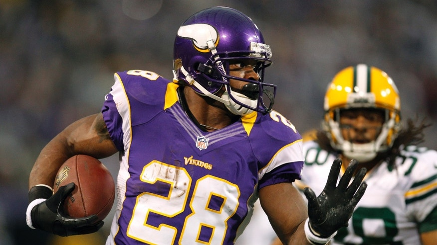Dec. 30, 2012: Minnesota Vikings running back Adrian Peterson, left, runs from Green Bay Packers cornerback Tramon Williams during the first half of an NFL football game in Minneapolis.