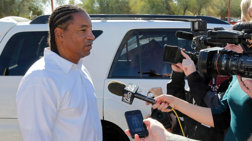 Arizona Cardinals defensive coordinator Ray Horton speaks with the media outside the team's NFL football training facility, Wednesday, Jan. 2, 2013, in Tempe, Ariz., after his first interview for the teams' vacant head coach position. Former head coach Ken Whisenhunt was relieved of duties last week. (AP Photo/Matt York)
