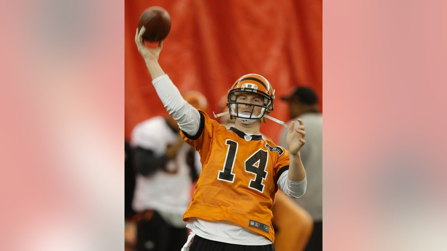 Cincinnati Bengals quarterback Andy Dalton throws a pass during practice under a dome at the University of Cincinnati, Wednesday, Jan. 2, 2013, in Cincinnati. Cincinnati plays at Houston this Saturday in an NFL playoff football game. (AP Photo/Al Behrman)