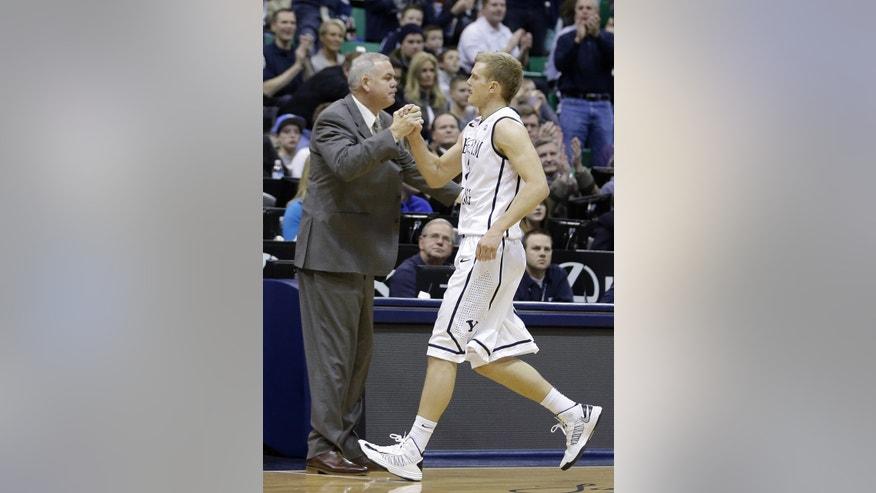 Brigham Young guard Tyler Haws, right, receives a hand shake from his head coach Dave Rose after leaving the game in the second half of an NCAA college basketball game  against Virginia Tech, Saturday, Dec. 29, 2012, in Salt Lake City. BYU defeated Virginia Tech 97-71. Haws scored 42 points. (AP Photo/Rick Bowmer)