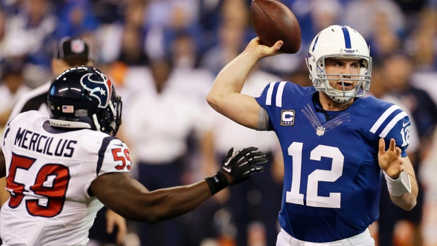 Indianapolis Colts' Andrew Luck (12) throws while pressured by Houston Texans' Whitney Mercilus (59) during the first half of an NFL football game on Sunday, Dec. 30, 2012, in Indianapolis. (AP Photo/Darron Cummings)