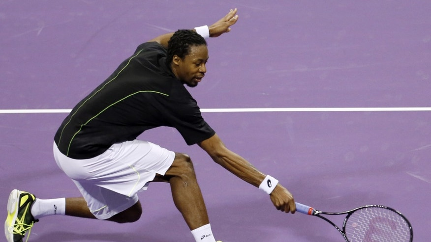 France's Gael Monfils returns the ball to German Philipp Kohlschreiber   during the Qatar ATP Open Tennis tournament in Doha, Qatar, Wednesday, Jan. 2, 2013.(AP Photo/Osama Faisal)