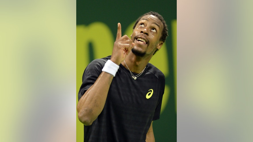 France's Gael Monfils celebrates winning his singles match German Philipp Kohlschreiber during the Qatar ATP Open Tennis tournament in Doha, Qatar, Wednesday, Jan. 2, 2013.(AP Photo/Osama Faisal)