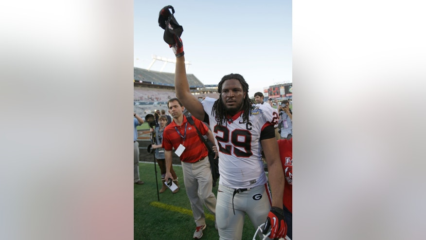 Georgia linebacker Jarvis Jones tips his hat to fans as he leaves the field after defeating Nebraska 45-31 in the Capital One Bowl NCAA football game, Tuesday, Jan. 1, 2013, in Orlando, Fla. (AP Photo/John Raoux)