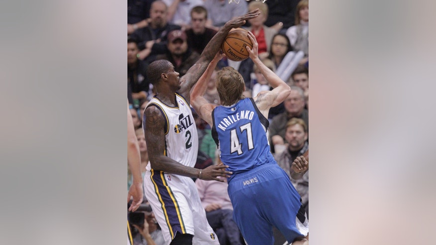 Utah Jazz power forward Marvin Williams (2) blocks the shot of Minnesota Timberwolves small forward Andrei Kirilenko (47) in the third quarter during an NBA basketball game on Wednesday, Jan. 2, 2013, in Salt Lake City. The Jazz defeated the Timberwolves 106-84.   (AP Photo/Rick Bowmer)