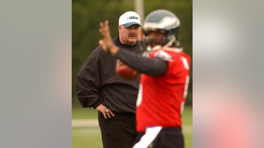 FILE - In a Friday, April, 29, 2005 file photo, Philadelphia Eagles coach Andy Reid, left, watches over quarterback Donovan McNabb during the minicamp drills at the team's training facility in Philadelphia. Reid has been fired after 14 seasons coaching the Philadelphia Eagles. The Eagles made the announcement Monday, Dec. 31, 2012.(AP Photo/Bradley C Bower, File)