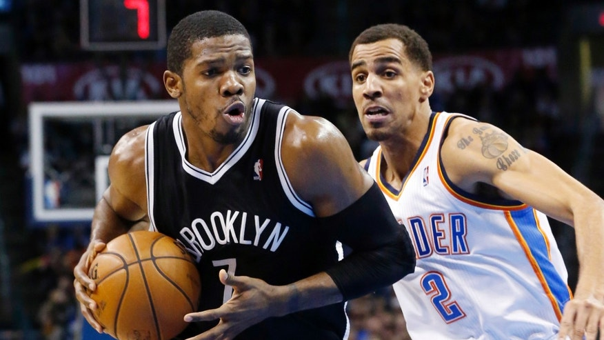 Brooklyn Nets guard Joe Johnson (7) drives past Oklahoma City Thunder guard Thabo Sefolosha (2) in the second quarter of an NBA basketball game in Oklahoma City, Wednesday, Jan. 2, 2013. (AP Photo/Sue Ogrocki)