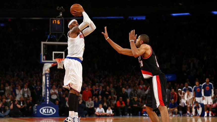 Carmelo Anthony #7 of the New York Knicks misses a three point shot as Nicolas Batum #88 of the Portland Trail Blazers defends on January 1, 2013 at Madison Square Garden in New York City. The Portland Trail Blazers defeated the New York Knicks 105-100. Photo by Elsa/Getty Images)