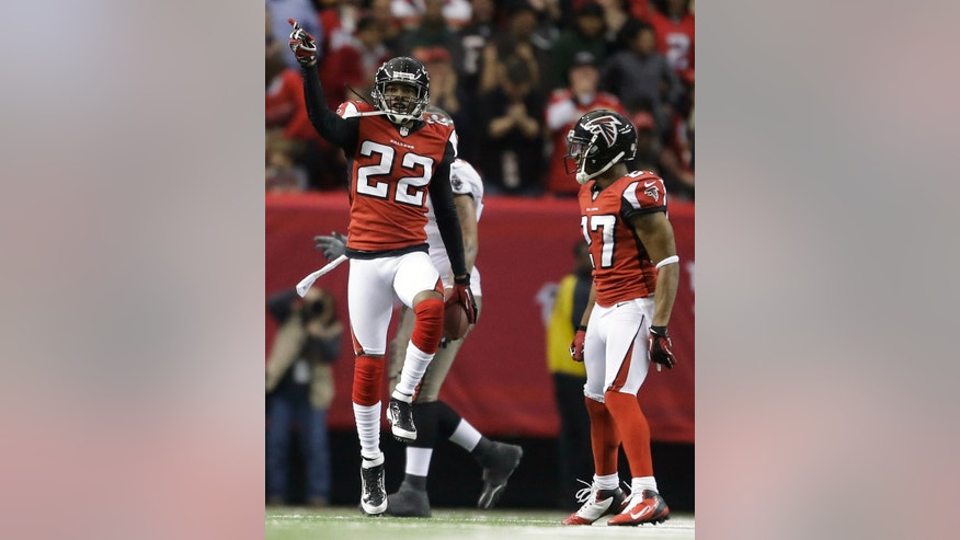 Atlanta Falcons cornerback Asante Samuel (22) reacts to an interception he made against the Tampa Bay Buccaneers during the second half of an NFL football game Sunday, Dec. 30, 2012, in Atlanta. (AP Photo/David Goldman)