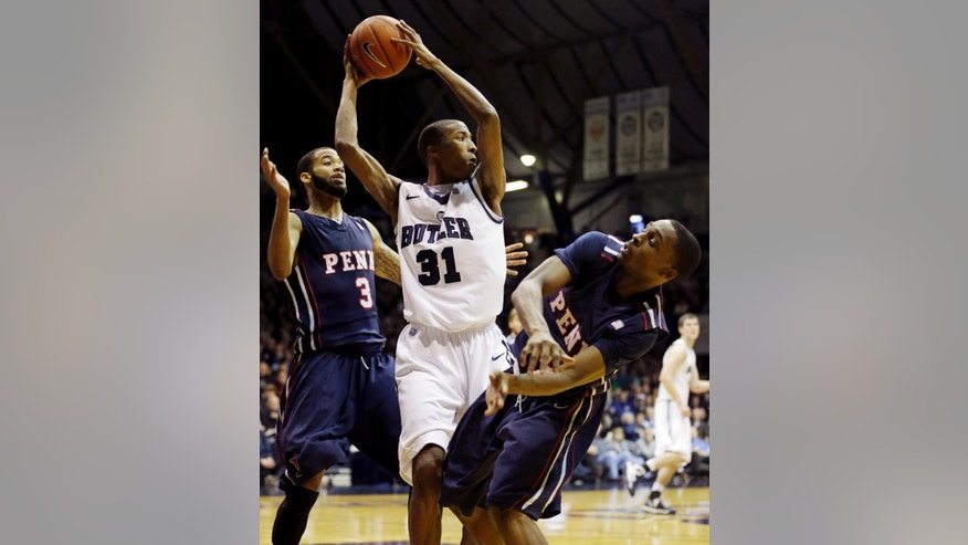 Butler's Kameron Woods (31) grabs a rebound from Pennsylvania's Henry Brooks (3) and Tony Hicks (1) during the first half of an NCAA college basketball game, Wednesday, Jan. 2, 2013, in Indianapolis. (AP Photo/Darron Cummings)