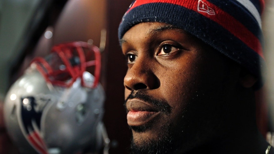 New England Patriots defensive end Chandler Jones talks with reporters in the locker room after an NFL football practice in Foxborough, Mass., Wednesday, Jan. 2, 2013. (AP Photo/Charles Krupa)