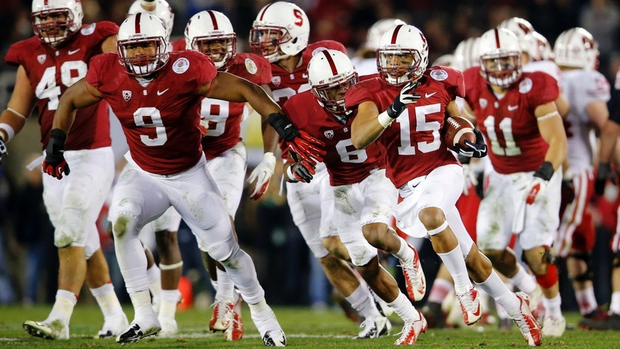 Jan. 1, 2013: Stanford cornerback Usua Amanam celebrates after a interception against Wisconsin late in the second half of the Rose Bowl NCAA college football game.