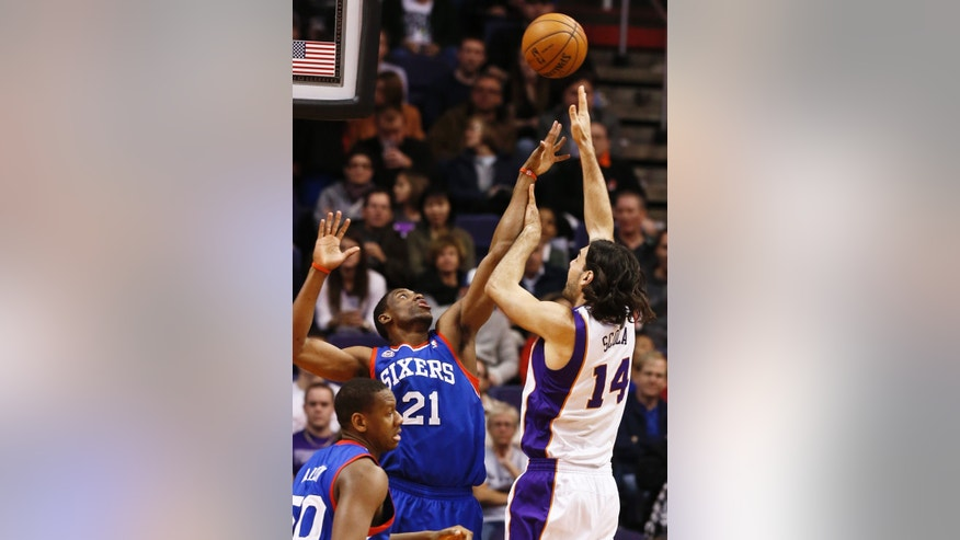 Phoenix Suns' Luis Scola (14), of Argentina, shoots over Philadelphia 76ers' Thaddeus Young (21) during the first half of an NBA basketball game, Wednesday, Jan. 2, 2013, in Phoenix. (AP Photo/Ross D. Franklin)