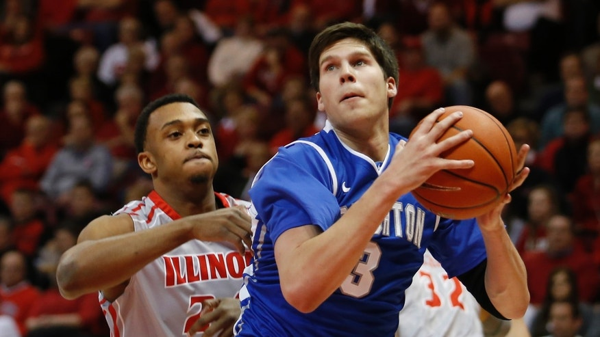 Creighton's Doug McDermott (3) looks for room to shoot past Illinois State's Zeke Upshaw (24) during the first half of an NCAA college basketball game at Redbird Arena Wednesday, Jan. 2, 2013, in Normal, Ill. (AP Photo/ Stephen Haas)