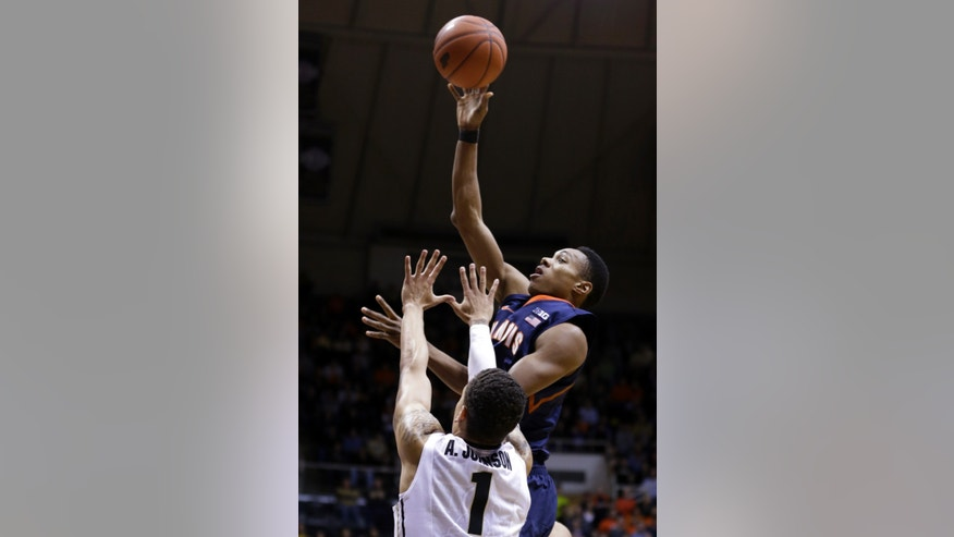 Illinois guard Joseph Bertrand, top, shoots over Purdue guard Anthony Johnson in the first half of an NCAA college basketball game in West Lafayette, Ind., Wednesday, Jan. 2, 2013. (AP Photo/Michael Conroy)
