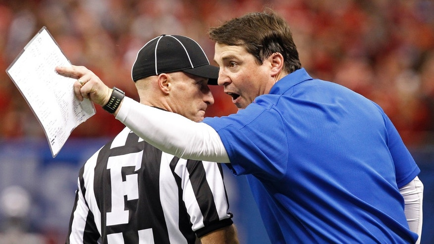 Florida head coach Will Muschamp aruges a call in the second half of the Sugar Bowl NCAA college football game against Louisville on Wednesday, Jan. 2, 2013, in New Orleans. (AP Photo/Butch Dill)