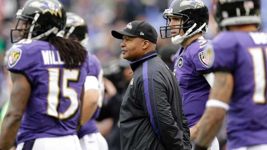 FILE - In this Dec. 16, 2012, Baltimore Ravens offensive coordinator Jim Caldwell watches the Ravens warm up before an NFL football game against the Denver Broncos in Baltimore.  A year ago, Caldwell was head coach of an Indianapolis Colts team that struggled through a 2-14 season without injured Peyton Manning. Now, as offensive coordinator of the Ravens, his job Sunday will be to help oust the new-look Colts from the NFL playoffs. (AP Photo/Patrick Semansky, File)