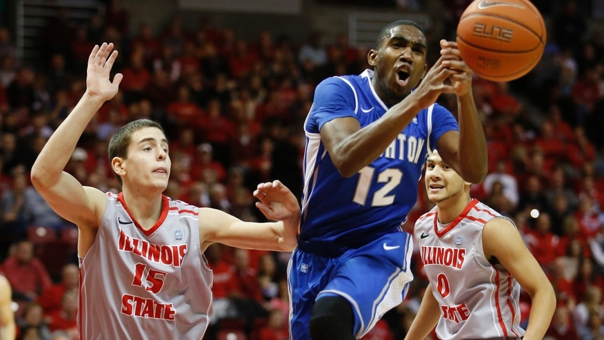 Creighton's Jahenns Manigat (12) loses control of the ball under pressure from Illinois State's Nick Zeisloft (15) and Kaza Keane (0) during the first half of an NCAA college basketball game at Redbird Arena, Wednesday, Jan. 2, 201,3 in Normal, Ill. (AP Photo/ Stephen Haas)
