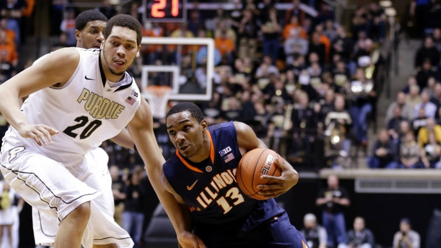 Illinois guard Tracy Abrams (13) drives around Purdue center A.J. Hammons in the first half of an NCAA college basketball game in West Lafayette, Ind., Wednesday, Jan. 2, 2013. (AP Photo/Michael Conroy)