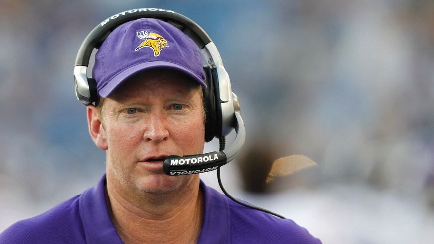 FILE - In this Aug. 13, 2011, file photo, Minnesota Vikings offensive coordinator Bill Musgrave walks the sideline during the first quarter of an NFL football preseason game against the Tennessee Titans in Nashville, Tenn. The Vikings offensive coordinator has shown plenty of imagination to get an offense with many limitations moving.(AP Photo/Wade Payne, File)