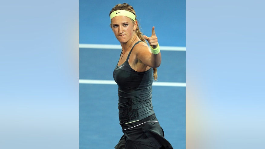 Victoria Azarenka of Belarus reacts after winning her second round match against Sabine Lisicki of Germany 6-3, 6-3 during the Brisbane International tennis tournament in Brisbane, Australia, Wednesday, Jan. 2, 2013.  (AP Photo/Tertius Pickard).