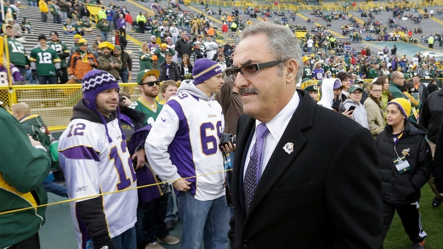 FILE - In this Dec. 2, 2012, file photo, Minnesota Vikings owner Zygi Wilf makes his way to the field before an NFL football game against the Green Bay Packers in Green Bay, Wis. He may not be Jerry Jones, but his approach is doing wonders for the Vikings as they head back to the playoffs, (AP Photo/Morry Gash, File)
