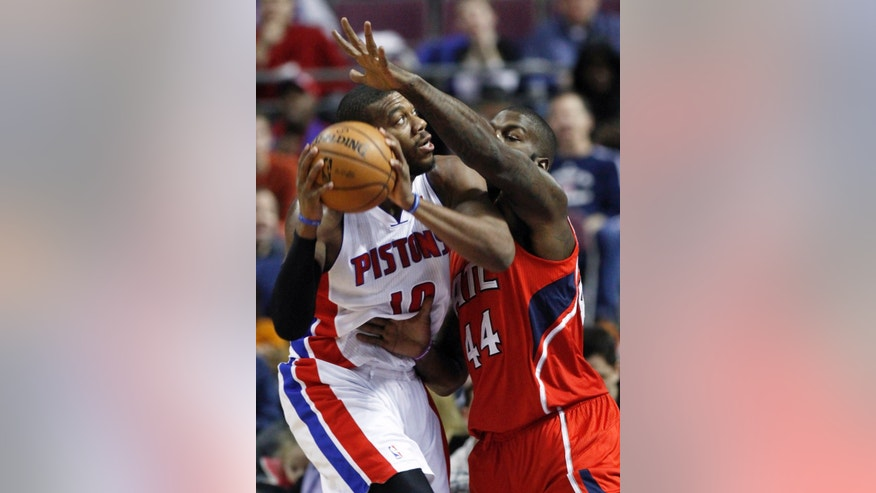 Detroit Pistons center Greg Monroe (10) goes the the basket against Atlanta Hawks forward Ivan Johnson (44) in the first half of an NBA basketball game, Friday, Jan. 4, 2013, in Auburn Hills, Mich. (AP Photo/Duane Burleson)