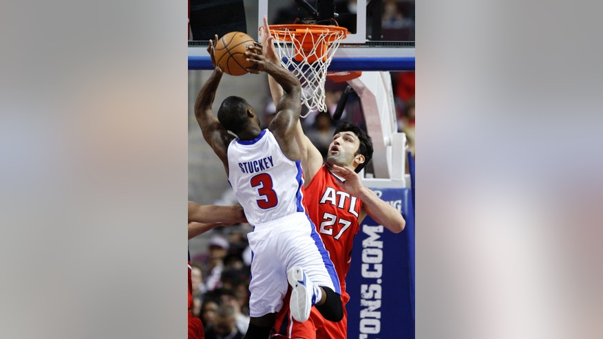 Atlanta Hawks center Zaza Pachulia (27) defends against a shot by Detroit Pistons guard Rodney Stuckey (3) in the first half of an NBA basketball game, Friday, Jan. 4, 2013, in Auburn Hills, Mich. (AP Photo/Duane Burleson)