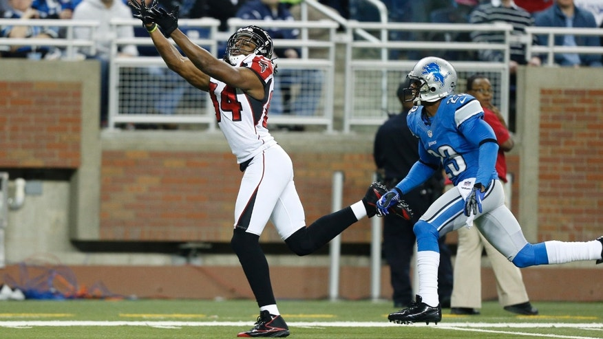FILE - This Dec. 22, 2012 file photo shows Atlanta Falcons wide receiver Roddy White, defended by Detroit Lions cornerback Chris Houston (23), catching a 44-yard pass before running into the end zone for a touchdown during the first quarter of an NFL football game at Ford Field in Detroit. White is disappointed to be left off the Pro Bowl after becoming just the fifth NFL wideout to post three straight seasons of 90 catches and 1,200 yards receiving. (AP Photo/Rick Osentoski, FIle)