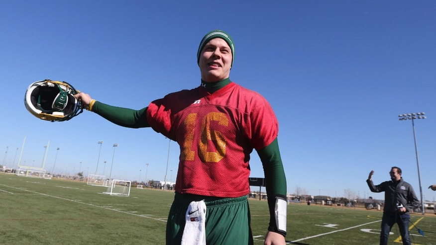 North Dakota State quarterback Brock Jensen answers a reporter's question after a closed team practice, Thursday, Jan. 3, 2013, in Frisco, Texas.  North Dakota State faces Sam Houston State in the FCS Championship NCAA college football game on Saturday. (AP Photo/LM Otero)