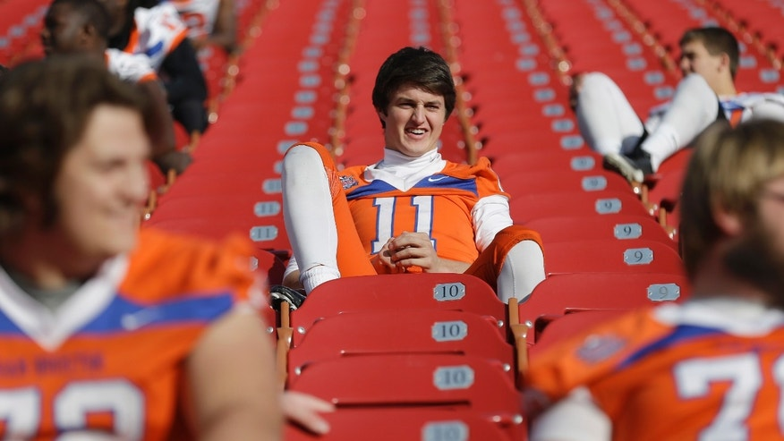 Sam Houston State quarterback Brian Bell waits for a team photo on Thursday, Jan. 3, 2013, in Frisco, Texas. North Dakota State is scheduled to play Sam Houston State in the FCS championship NCAA college football game on Saturday. (AP Photo/LM Otero)