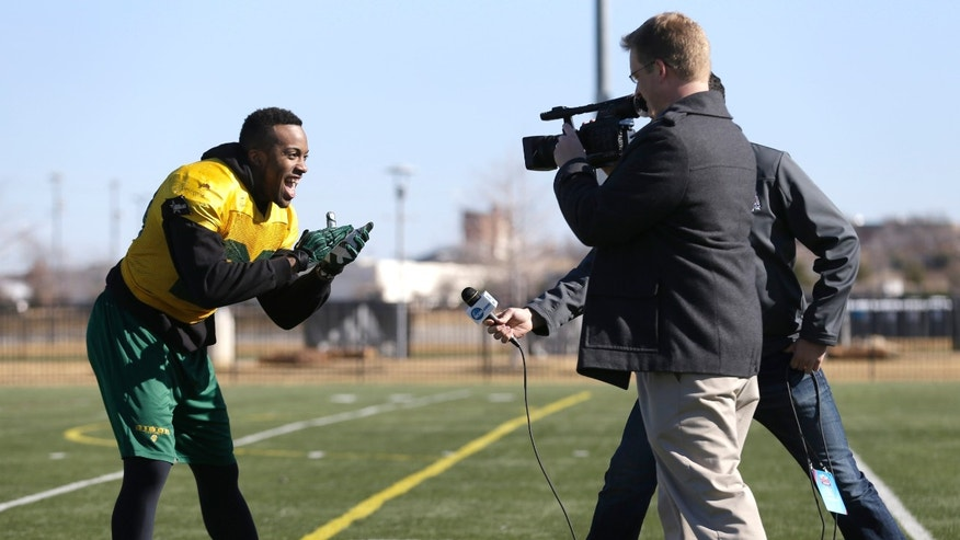 North Dakota State running back John Crockett shows some team spirit for a news crew after a closed team practice, Thursday, Jan. 3, 2013, in Frisco, Texas.  North Dakota State faces Sam Houston State in the FCS Championship NCAA college football game on Saturday. (AP Photo/LM Otero)