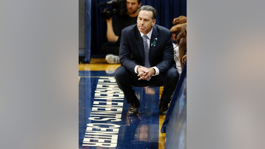 Pittsburgh head coach Jamie Dixon squats in front of the bench late in the second half of their NCAA college basketball game against Cincinnati, Monday, Dec. 31, 2012, in Pittsburgh. Cincinnati won 70-61. (AP Photo/Keith Srakocic)