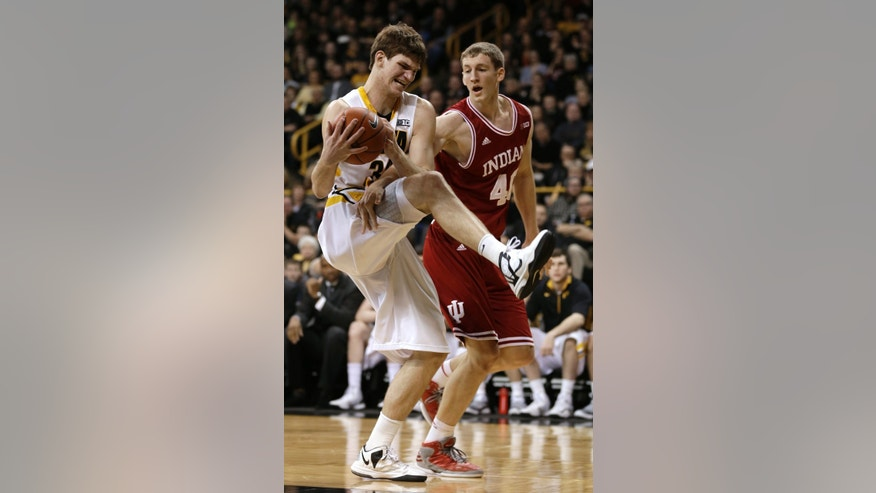 Iowa center Adam Woodbury, left, keeps a rebound away form Indiana forward Cody Zeller during the first half of an NCAA college basketball game, Monday, Dec. 31, 2012, in Iowa City, Iowa. (AP Photo/Charlie Neibergall)