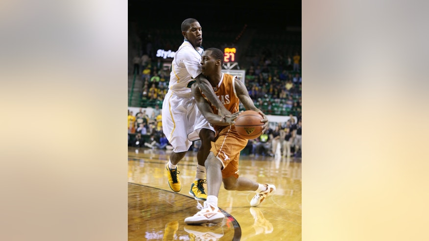 Baylor's A.J. Walton, left, reaches in on Texas Sheldon McClellan during the first half of an NCAA college basketball game, Sat, Jan. 5, 2013, in Waco, Texas. (AP Photo/Waco Tribune Herald, Rod Aydelotte)