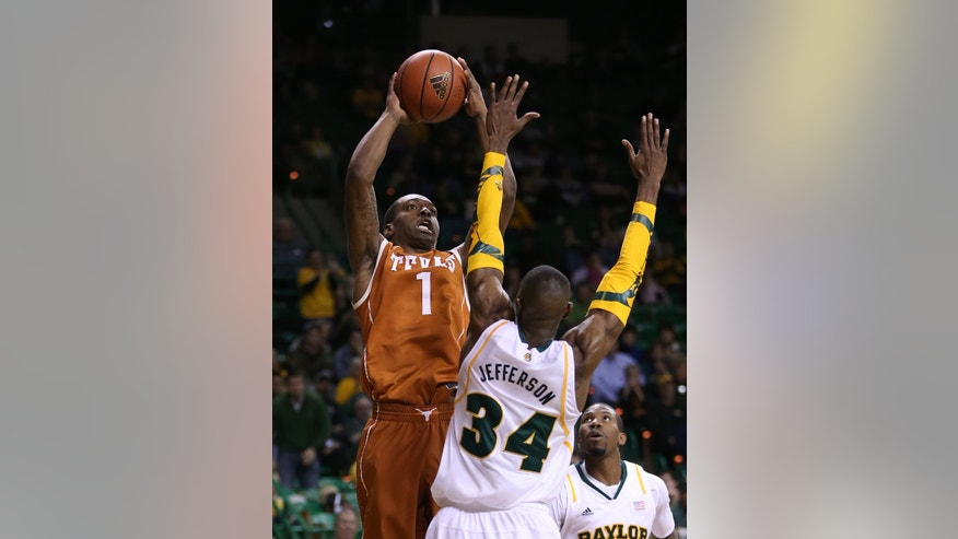 Texas' Sheldon McClellan (1) shoots over Baylor's Cory Jefferson (34) during the first half of an NCAA college basketball game, Saturday, Jan. 5, 2013, in Waco, Texas. (AP Photo/Waco Tribune Herald, Rod Aydelotte)