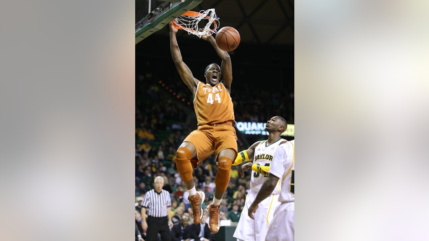 Texas' Prince Ibeh (44) dunks over Baylor's Cory Jefferson right, during the first half of an NCAA college basketball game, Saturday, Jan. 5, 2013, in Waco, Texas. (AP Photo/Waco Tribune Herald, Rod Aydelotte)