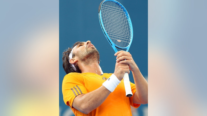 Marcos Baghdatis of Cyprus reacts after playing a shot in his semi final match against Grigor Dimitrov of Bulgaria during the Brisbane International tennis tournament in Brisbane, Australia, Saturday, Jan 5, 2013.  (AP Photo/Tertius Pickard).