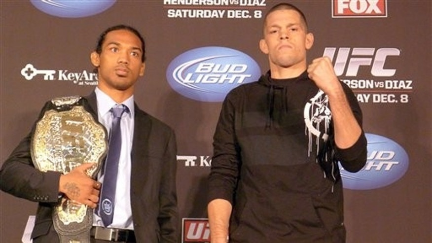 UFC lightweight champion Benson Henderson, left, and challenger Nate Diaz pose on Thursday Dec. 6, 2012 in advance of their main event Saturday on a UFC televised card.  (AP Photo/The  Canadian Press, Neil Davidson)