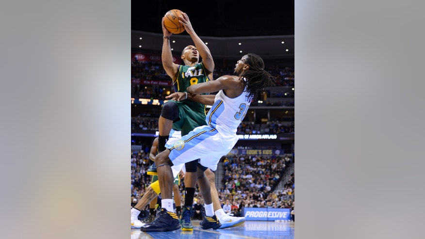 Utah Jazz guard Randy Foye (8) is fouled by Denver Nuggets forward Kenneth Faried (35) during the third quarter of an NBA basketball game on Saturday, Jan. 5, 2013, in Denver. (AP Photo/Jack Dempsey)