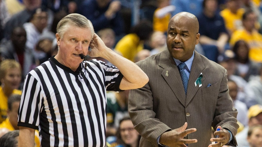 Georgetown coach John Thompson III, right, gestures next to an official during the second half of an NCAA college basketball game against Marquette Saturday, Jan. 5, 2013, in Milwaukee. (AP Photo/Tom Lynn)