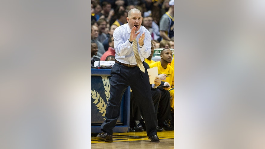 Marquette coach Buzz Williams encourages his team during the second half of an NCAA college basketball game against Georgetown, Saturday, Jan. 5, 2013, in Milwaukee. (AP Photo/Tom Lynn)