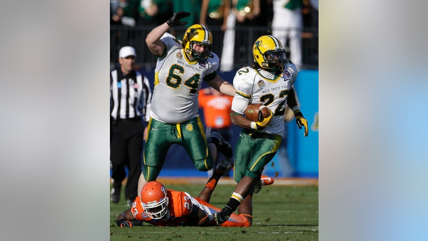 North Dakota State's Josh Colville (64) follows as Sam Ojuri (22) finds running room after getting by Sam Houston State's Robert Shaw (23) during the second half of the FCS Championship NCAA college football game, Saturday, Jan. 5, 2013, in Frisco, Texas. NDSU won 39-13. (AP Photo/Tony Gutierrez)